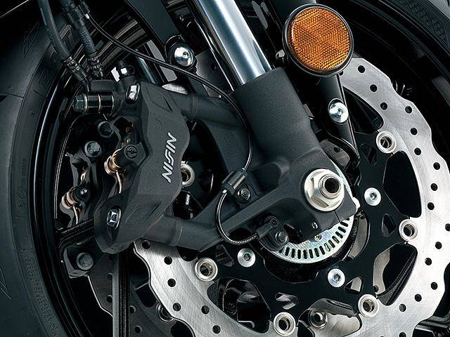 Radial mounted four-piston opposed front calipers
